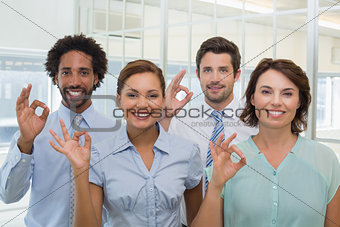 Business colleagues gesturing okay sign