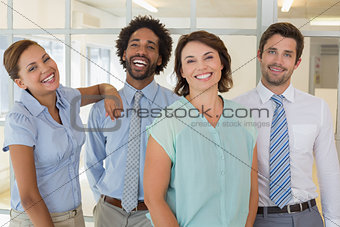 Portrait of happy business people in office