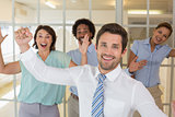 Cheerful young business colleagues cheering