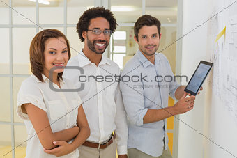 Portrait of business people with digital tablet in office