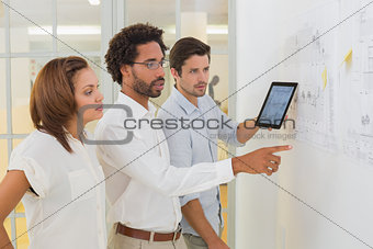 Business people using digital tablet in meeting at office