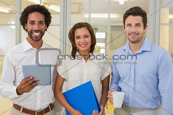 Business colleagues holding folder coffee cup and digital tablet in office