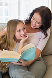 Mother and daughter with story book