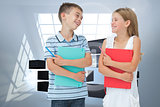 Composite image of smiling brother and sister holding their exercise books
