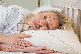 Sleepy woman lying in bed