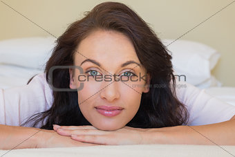 Close-up of beautiful woman lying in bed