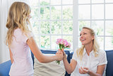 Mother receiving roses from loving daughter