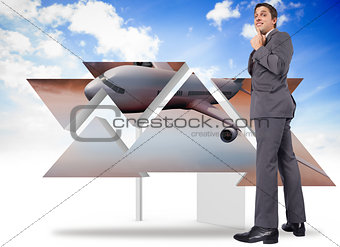 Composite image of thinking businessman with hand on chin