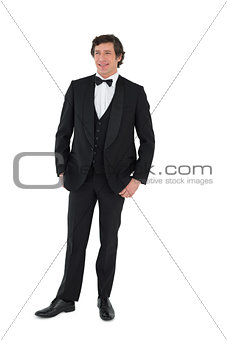 Groom posing over white background