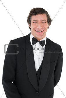 Portrait of groom in tuxedo smiling
