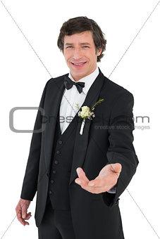 Handsome groom offering his hand