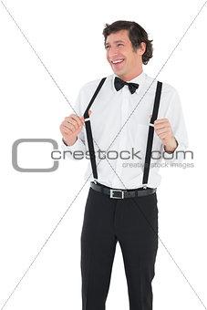 Groom stretching his suspenders