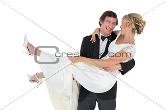 Loving groom carrying bride