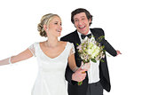 Happy newlywed couple holding bouquet
