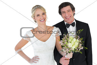 Beautiful newlywed couple holding bouquet