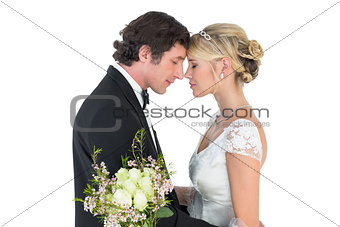 Romantic couple standing head to head