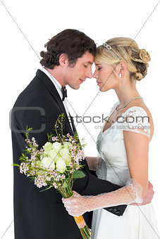 Newlywed couple standing head to head