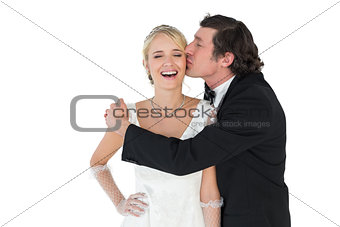 Groom kissing attractive bride