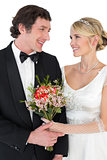 Bride and groom with flower over white background