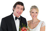 Newly wed couple smiling over white background