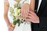 Newly wed couple showing wedding rings