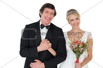 Bride and groom holding hands over white background
