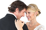 Bride and groom embracing over white background