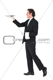Waiter carrying tray over white background