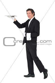 Server carrying tray over white background