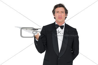 Server with attitude holding tray against white background