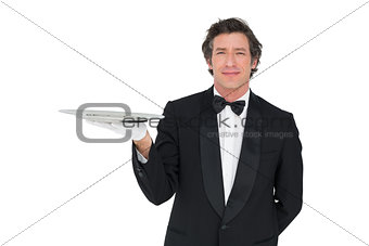Confident waiter holding serving tray