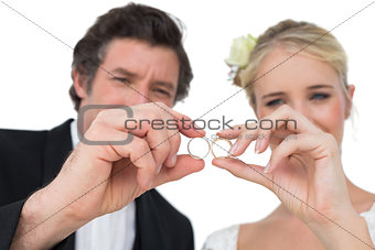 Bride and groom looking at wedding rings