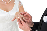 Loving bride and groom exchanging wedding ring