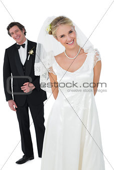 Bride standing with groom over white background