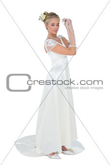 Bride with eyes closed over white backgtround