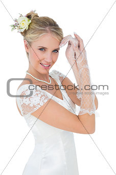 Smiling bride posing over white background