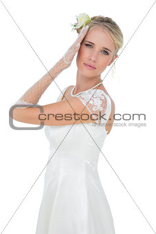 Beautiful young bride posing over white background