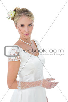 Confident bride standing over white background