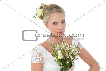 Bride holding bouquet against white background