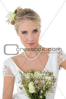Bride with bouquet against white background