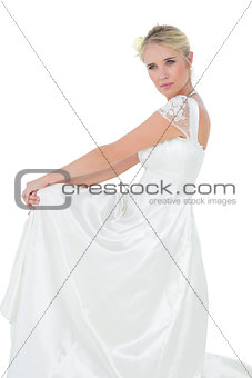 Bride looking away against white bakground