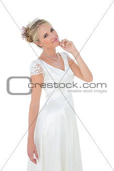 Portrait of smiling bride with hand on chin
