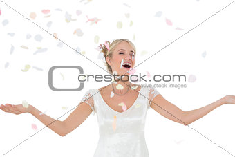 Beautiful bride being showered with petals