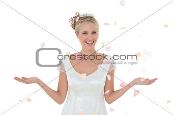 Bride being showered with petals over white background