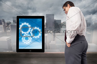 Composite image of thinking businessman touching his glasses