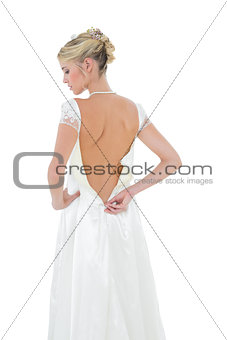 Bride getting dressed against white background