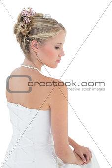 Bride in off shoulder dress against white background