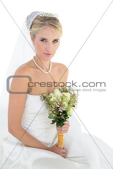 Portrait of bride holding flower bouquet