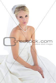 Portrait of young bride in off shoulder dress