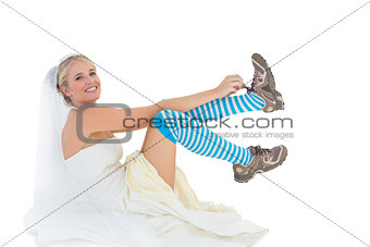 Bride wearing sports shoes over white background